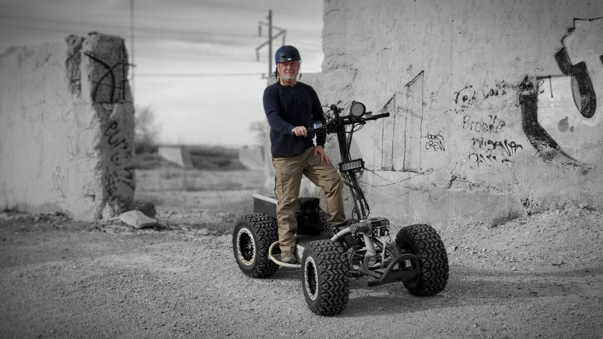 This electric stand-up ATV can traverse rugged terrains with speeds up to 40 mph