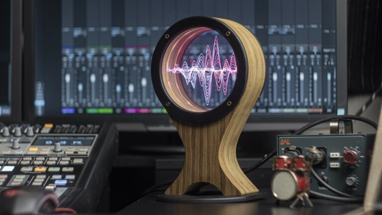 AmbiColoredLight LED Headphone Stand has a large color-changing lantern and a remote