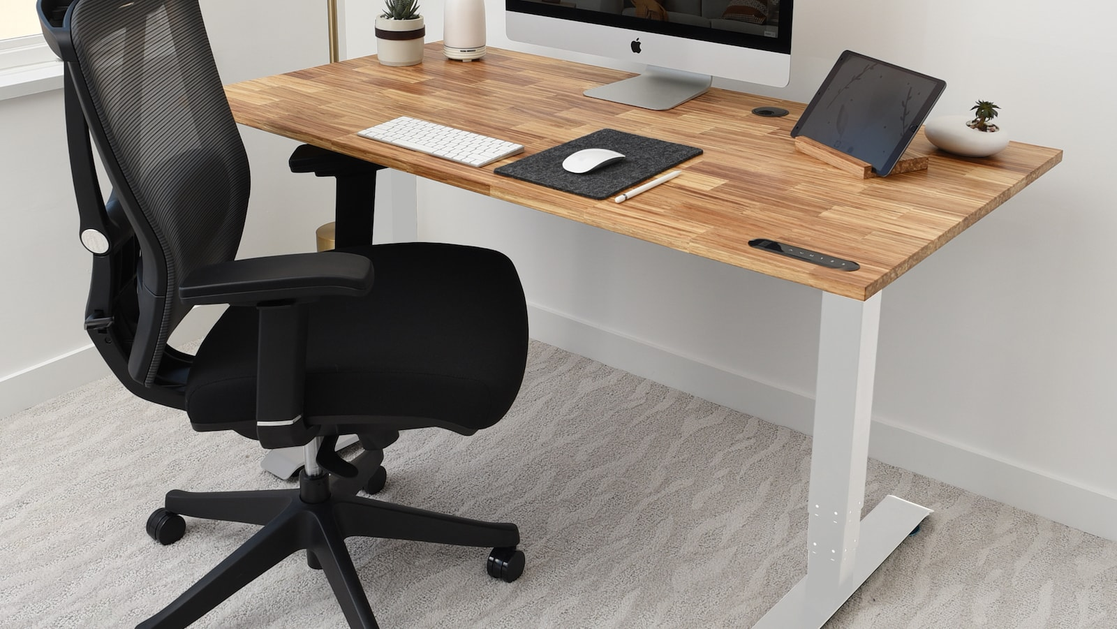 Work at this office standing desk that's motorized and has a built-in gyroscope
