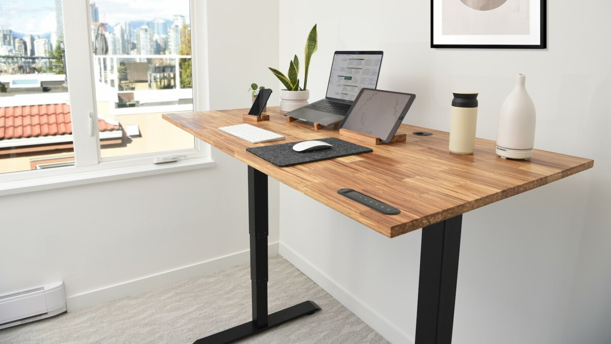 This business office standing desk is motorized and can be adjusted for sitting or standing