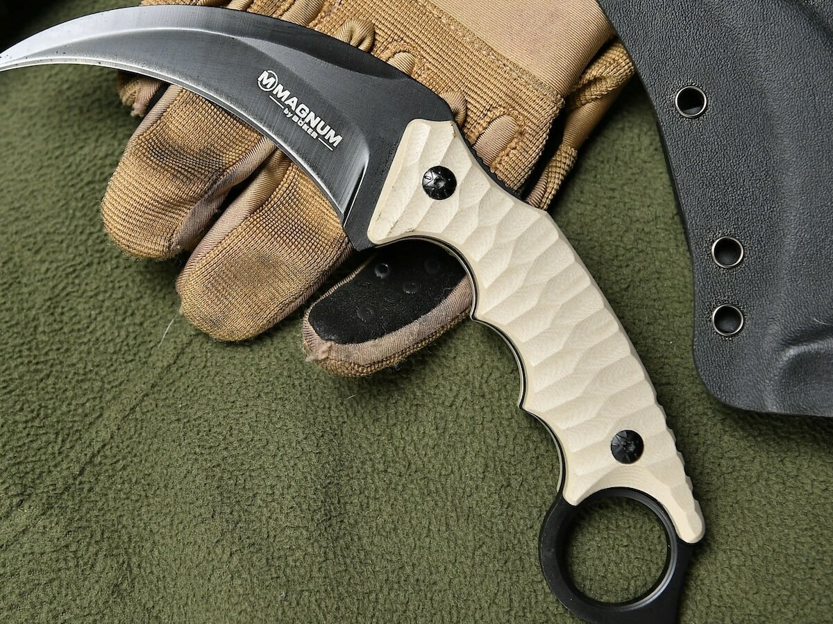 Fixed Karambit steel multiuse knife has no moving parts for strength and reliability