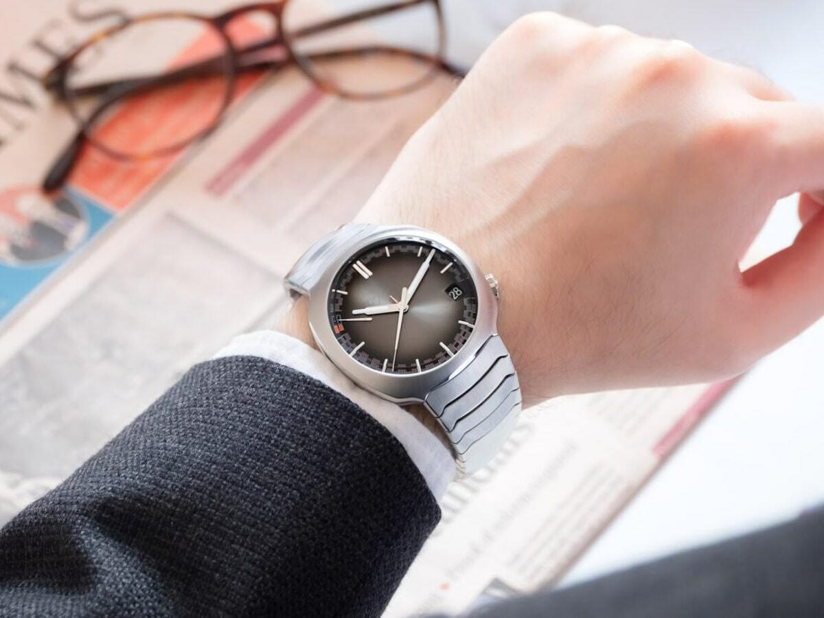 H. Moser & Cie. Streamliner Perpetual Calendar steel watch features 3D hour & minute hands