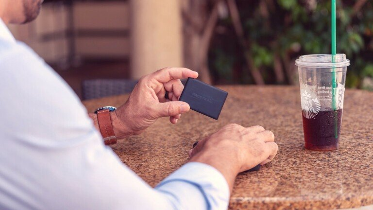 PaceTrail Global Card Tracker offers worldwide coverage and a built-in NFC business card