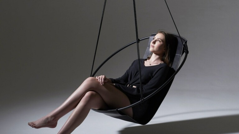 Wescover Sling Minimalist Hanging Swing Chair has a circular frame with clean lines