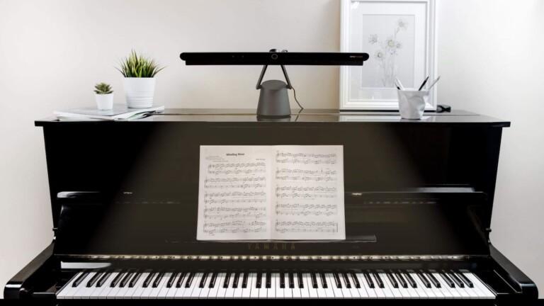 BenQ PianoLight eye care lamp illuminates sheet music and piano keys for better playing